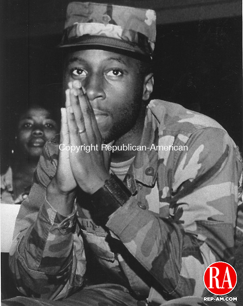 November 25, 1990 - WATERBURY - Stanley Collins of Waterbury listen to the Governor at the New Haven Armory. He is part of the 142nd Medical Company that is shipping out to the Persian Gulf. Photo by Cheryl Lucas Republican-American