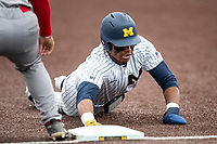 Michigan Wolverines outfielder Jordan Nwogu (42) dives back to first base during a pickoff attempt against the Rutgers Scarlet Knights on April 27, 2019 in the NCAA baseball game at Ray Fisher Stadium in Ann Arbor, Michigan. Michigan defeated Rutgers 10-1. (Andrew Woolley/Four Seam Images)