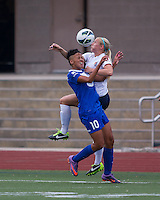 Sky Blue FC defender Kendall Johnson (5) and Boston Breakers forward Lianne Sanderson (10) compete for a high ball.  In a National Women's Soccer League Elite (NWSL) match, Sky Blue FC defeated the Boston Breakers, 3-2, at Dilboy Stadium on June 16, 2013