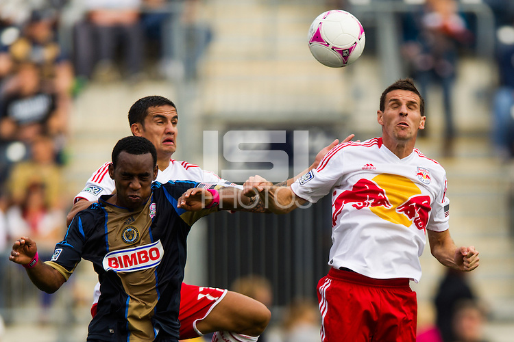 Amobi Okugo (14) of the Philadelphia Union goes up for a header with Tim Cahill (17) and Sebastien Le Toux (9) of the New York Red Bulls. The New York Red Bulls defeated the Philadelphia Union 3-0 during a Major League Soccer (MLS) match at PPL Park in Chester, PA, on October 27, 2012.