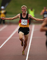 Waikato Bay of Plenty's Aaron Pulford celebrates victory in the men's under-19 5000m during the National athletics championships at Newtown Park, Wellington, New Zealand on Friday, 27 March 2009. Photo: Dave Lintott / lintottphoto.co.nz