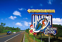 This colorful sign welcomes vacationing drivers to stop in and enjoy the sights, sounds and shopping available in the quaint town of Haliewa located on the north shore of Oahu.
