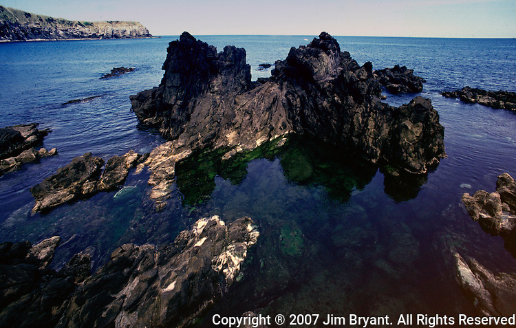 Volcanic rock formations in the ocean near Biscoitos make for ideal snorkeling and diving on Terceira, Azores. Far out in the Atlantic Ocean, some 850 miles off the western coast of Lisbon, Portugal lies the 425-mile long archipelago of the Azores. (Jim Bryant Photo)...