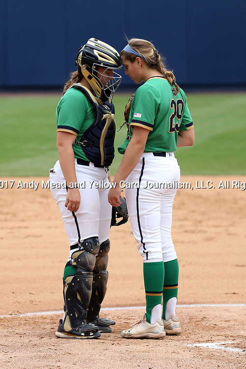 CHAPEL HILL, NC - MAY 11: Notre Dame's Katie Beriont (29) meets with catcher Maddie McCracken (left) during the bottom of the first inning. The #4 Boston College Eagles played the #5 University of Notre Dame Fighting Irish on May 11, 2017, at Anderson Softball Stadium in Chapel Hill, NC in a 2017 Atlantic Coast Conference Tournament Quarterfinal Softball game. Notre Dame won the game 9-5 in eight innings.