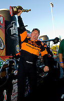 Sept. 19, 2010; Concord, NC, USA; NHRA top alcohol dragster driver Monroe Guest celebrates after winning the O'Reilly Auto Parts NHRA Nationals at zMax Dragway. Mandatory Credit: Mark J. Rebilas-
