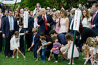 United States President Donald J. Trump and First Lady Melania Trump  blow a whistle to start an egg roll during the annual Easter Egg Roll on the South Lawn of the White House  in Washington, DC, on April 17, 2017. <br /> CAP/MPI/CNP/RS<br /> &copy;RS/CNP/MPI/Capital Pictures