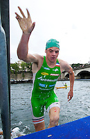 09 JUL 2011 - PARIS, FRA - Jonathan Brownlee (EC Sartrouville) runs up the steps as he leaves the swim during the men's French Grand Prix series race (PHOTO (C) NIGEL FARROW)