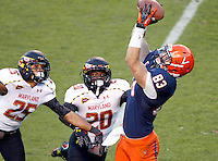 Virginia Cavaliers tight end Jake McGee (83) makes a touchdown catch next to Maryland Terrapins defensive back Dexter McDougle (25) and Maryland Terrapins defensive back Anthony Nixon (20) during the game in Charlottesville, Va. Maryland defeated Virginia 27-20.