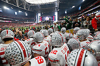 Ohio State Buckeyes players take the field prior to the Battlefrog Fiesta Bowl against the Notre Dame Fighting Irish at University of Phoenix Stadium in Glendale, Arizona on Jan. 1, 2016. (Adam Cairns / The Columbus Dispatch)