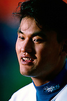 Chan Ho Park of the Los Angeles Dodgers during a game at Dodger Stadium in Los Angeles, California during the 1997 season.(Larry Goren/Four Seam Images)