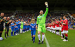 St Johnstone v Man Utd XI....31.07.10  Alan Main Testimonial.Alan Main walks onto the pitch with son Kristofer (9).Picture by Graeme Hart..Copyright Perthshire Picture Agency.Tel: 01738 623350  Mobile: 07990 594431