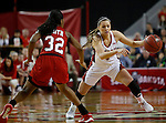 VERMILLION, SD - MARCH 27, 2016 -- Tia Hemiller #4 of South Dakota dribbles around Kayla Smith #32 of Western Kentucky during their WNIT game Sunday evening at the Dakotadome in Vermillion, S.D.  (Photo by Dick Carlson/Inertia)
