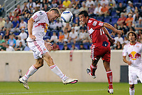 Chris Albright (3) of the New York Red Bulls heads the ball as Pavel Pardo (17) of the Chicago Fire watches. The New York Red Bulls and the Chicago Fire played to a 2-2 tie during a Major League Soccer (MLS) match at Red Bull Arena in Harrison, NJ, on August 13, 2011.