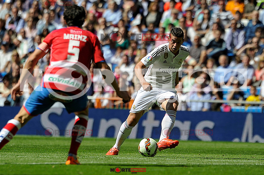 Real Madrid´s James Rodriguez and Granada´s Diego Mainz during 2014-15 La Liga match between Real Madrid and Granada at Santiago Bernabeu stadium in Madrid, Spain. April 05, 2015. (ALTERPHOTOS/Luis Fernandez) /NORTEphoto.com