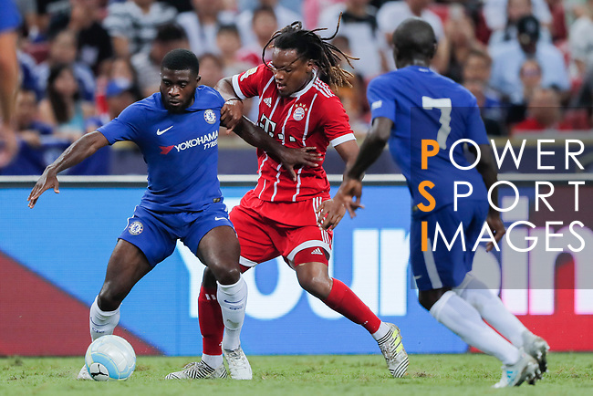 Bayern Munich Midfielder Renato Sanches (C) fights for the ball with Chelsea Midfielder Jeremie Boga (R) during the International Champions Cup match between Chelsea FC and FC Bayern Munich at National Stadium on July 25, 2017 in Singapore. Photo by Marcio Rodrigo Machado / Power Sport Images