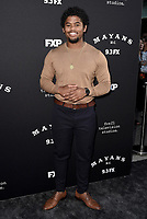 """LOS ANGELES - AUGUST 27: Isaiah John attends the season two red carpet premiere of FX's """"Mayans M.C"""" at the ArcLight Dome on August 27, 2019 in Los Angeles, California. (Photo by Scott Kirkland/FX/PictureGroup)"""