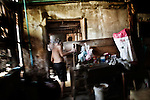 "KADEEJEEN, BANGKOK, THAILAND, DECEMBER 2012:..Local Houses in Kadeejeen where people works and lives, this kind of houses are called "" shop House "", Dec 2012..The Kadeejeen neighbourhood comprises six communities  Wat Kalaya, Kudeejeen, Wat Prayurawong, Wat Bupparaam, Kudee Khao and Roang Kraam...Ever since the Thonburi era (in the 17th Century), these historic neighbourhoods have maintained the diverse cultural heritage of three religions and four beliefs (Theravada Buddhism, Mahayana Buddhism, Christianity and Muslim) while coexisting in peaceful harmony...The neighbourhood is still characterised by Bangkok's traditional urbanism which is that of a fine-grained, religious establishment-centred urban structure with close-knit social cohesion. ©Giulio Di Sturco/Reportage by Getty Images."