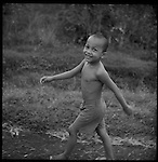 A young Balinese boy walks in his village.