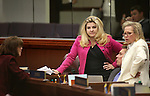 Nevada Assembly Republicans, from left, Robin Titus, Michele Fiore, Brent Jones, seated, and Victoria Dooling talk on the Assembly floor at the Legislative Building in Carson City, Nev., on Tuesday, April 21, 2015. <br /> Photo by Cathleen Allison