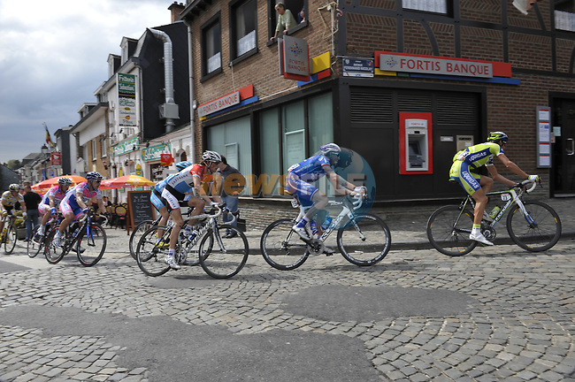 The peleton with Roman Kreuziger (CZE) Liquigas, Christophe Moreau (FRA) Agritubel and Frank Schleck (LUX) Saxo Bank pass through the Stavelot during the 95th running of Liege-Bastogne-Liege cycle race, running 261km from Liege to Ans, Belgium. 26th April 2009 (Photo by Eoin Clarke/NEWSFILE)