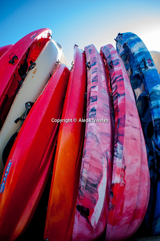 Friday  13  June  2014<br /> <br /> Pictured: Rows of Canoes and Kyaks near the Beach in LLangrannog, Wales, UK <br /> Re: Views of Llangrannog, Ceredigion, Wales UK