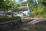 Pretty traditional thatched cottages in the village of Helford village, Cornwall, England