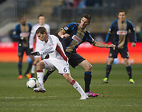 Sebastien Le Toux (11) of the Philadelphia Union fights for the ball with Scott Caldwell (6) of the New England Revolution during the game at PPL Park in Chester, PA.  The Philadelphia Union defeated the New England Revolution, 1-0.