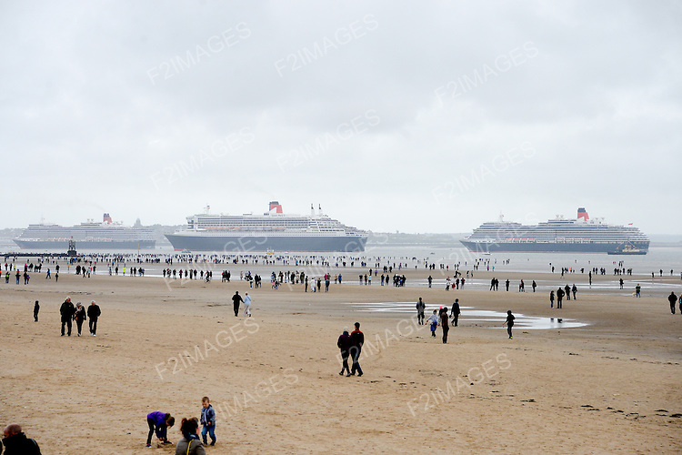 Cunard Line's Three Queens Meeting Liverpool. <br /> Crosby Beach 25.5.15  Queen Victoria , Queen Elizabeth, and Queen Mary 2 pictured on the River Mersey before starting their journey into Liverpool.