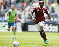 Colorado Rapids forward Omar Cummings dribbles the ball during play against the Seattle Sounders FC at CenturyLink Field in Seattle Saturday July 17, 2011. The Sounders won the game 4-3.