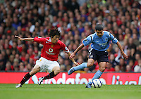 Matthew Ashton / Back Page Images.FA Barclays Premiership.Manchester United v Manchester City.10th September, 2005.Manchester United's Ji-Sung Park and Claudio Reyna of Manchester City.