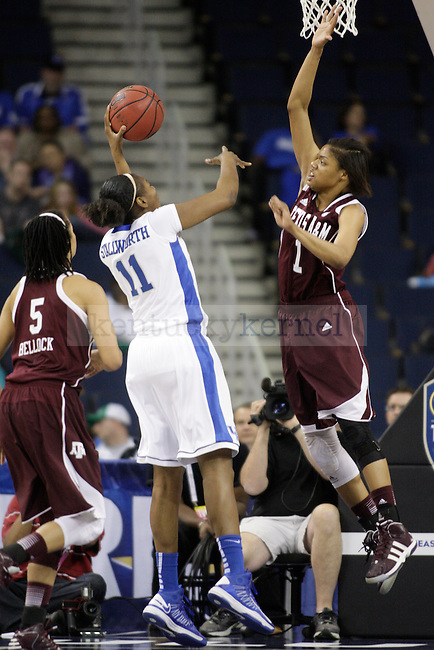 TAMU forward Courtney Williams jumps to block a shot by UK center DeNesha Stallworth during the first half of the University of Kentucky women's basketball game vs. Texas A&M University during the SEC Tournament Championship Game at The Arena at Gwinnett Center in Duluth, Ga., on Sunday, March 10, 2013. UK lost 75-67. Photo by Tessa Lighty | Staff