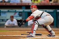 Philadelphia Phillies catcher Carlos Ruiz #51 waits for a throw home for a force out during the second inning of the Major League Baseball game against the Houston Astros at Minute Maid Park in Houston, Texas on September 14, 2011. Philadelphia defeated Houston 1-0 to clinch a playoff berth.  (Andrew Woolley/Four Seam Images)