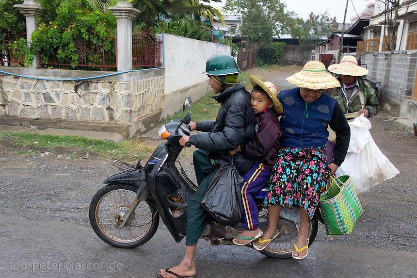 family on motor bike, village  Nyaungshwe close to  Inle Lake, Shan state,  Myanmar, 2011