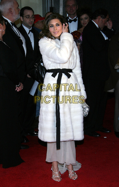 JAMIE LYNN SIGLER.2005 International Emmy Awards held at the New York Hilton, New York..USA, United States..21st November 2005.Ref: ADM/JL.full length white fur coat black belt belted around waist curls curled ringlets hair tucking hair behind ear.www.capitalpictures.com.sales@capitalpictures.com.© Capital Pictures..