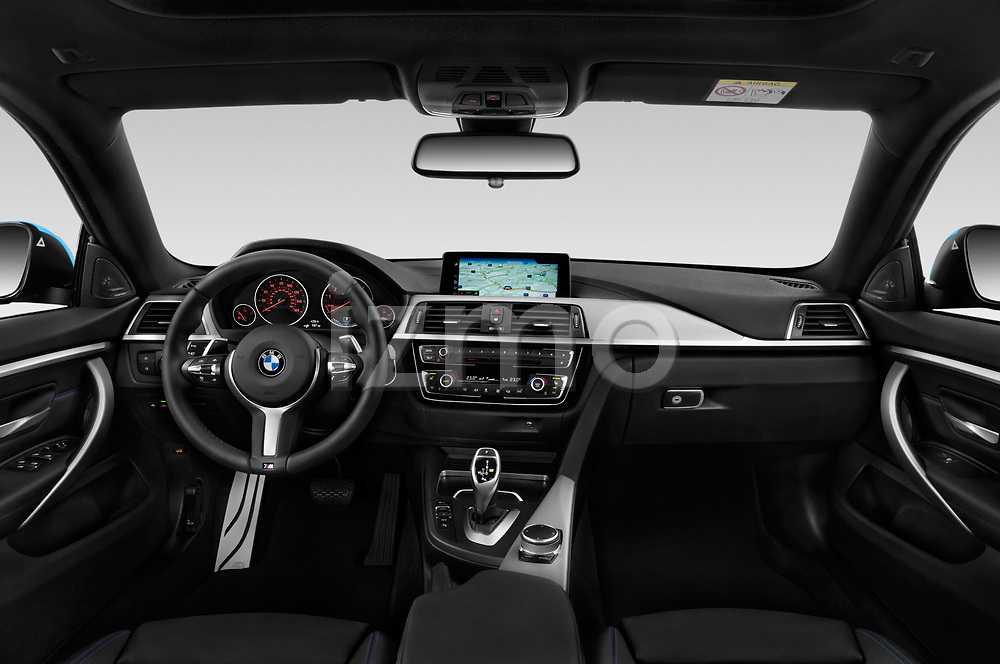 Stock photo of straight dashboard view of a 2018 BMW 4 Series Gran Coupe 440i M Sport 5 Door Hatchback