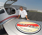 Air show favorite and 2008 National Aviation Hall of Fame inductee Sean D. Tucker is on the ramp at Piqua Hartzell Airport with one of his aircraft. Tucker is a frquent visitor to Piqua where the Hartzell Propeller Company takes care of the prop on his bright red Oracle Challenger.