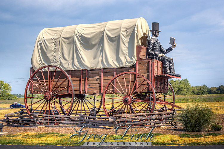The world's largest covered wagon sits on Route 66 in Lincoln Illinois.  The Railsplitter Covered Wagon is recognized by the Guinness Book of World Records as the largest in the world.  The wagon weighs five tons and measures 40 feet long, 12 feet wide, and 24 feet tall.  Abe Lincoln, seated in the front reading a book, weighs 350 pounds and measures 12 feet tall.