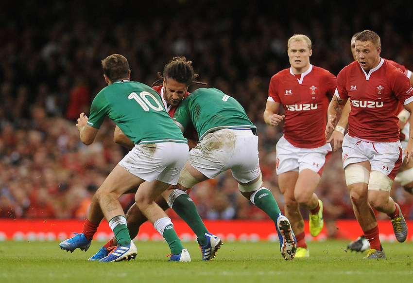 Wales Josh Navidi takes on Ireland's Peter O'Mahony and Jack Carty<br /> <br /> Photographer Ian Cook/CameraSport<br /> <br /> 2019 Under Armour Summer Series - Wales v Ireland - Saturday 31st August 2019 - Principality Stadium - Cardifff<br /> <br /> World Copyright © 2019 CameraSport. All rights reserved. 43 Linden Ave. Countesthorpe. Leicester. England. LE8 5PG - Tel: +44 (0) 116 277 4147 - admin@camerasport.com - www.camerasport.com