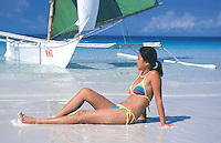 Girl and Small sailboat on the island of Boracay,Philippines