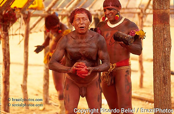 Xingu, Amazon, Brazil. Yaulapiti indigenous People. Body painting with urucum, an red-colored plant.