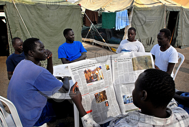 Men sit together near their tents in a special detention facility within Ketziot Prison compound, designated for African asylum seekers who have illegally crossed the nearby Egyptian border into Israel.