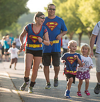 NWA Democrat-Gazette/ANTHONY REYES • @NWATONYR<br /> Alisha Damut, from left, runs with her husband Jared Dalmut and son Mason Dalmut, 3, all of Rogers, Monday, Sept. 7, 2015 at the 12th Annual Run for a Child's Hunger race at the Promenade in Rogers. Alisha ran in the 10k and in the one mile fun run with her family. The race has teamed up with Care Community Center to help fight hunger in the region. The event featured multiple activities including a 10K race, 5K race, fun run, inflatable playground for children and a free breakfast.