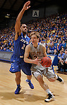 SIOUX FALLS, SD - MARCH 11:  Nate Wolters of South Dakota State drives past Pierre Bland #2 of IPFW during their semi-final game at the 2013 Summit League Basketball Championships Monday at the Sioux Falls Arena.  (Photo by Dick Carlson/Inertia)