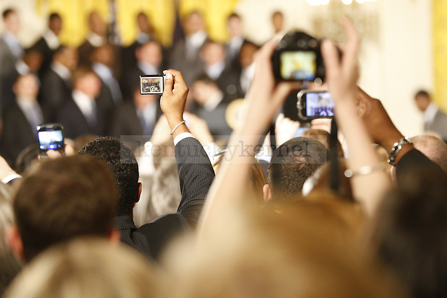 Members of the audience hold up cameras to take photographs during the UK National Championship Celebration in the East Room of the White House, in Washington D.C., May 4, 2012. Photo by Brandon Goodwin   Staff