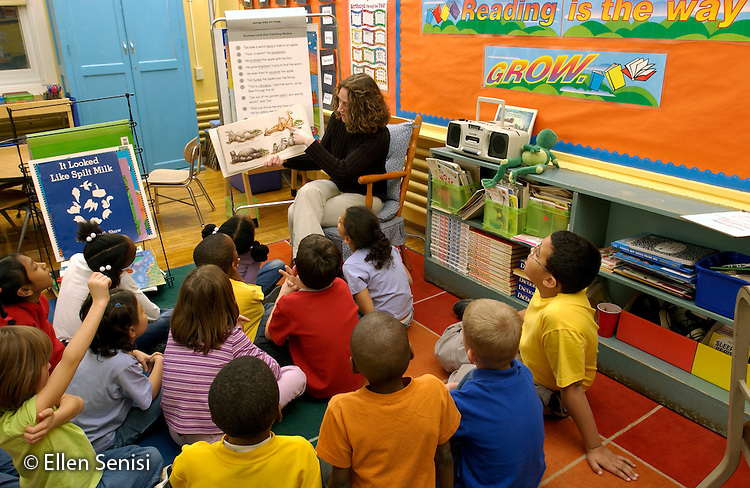 MR / Schenectady, NY.Yates Arts-in-Education Magnet Schl (urban elementary schl) Grade 2.Teacher reads book to class at storytime..MR: AC-g2f, Fa12.©Ellen B. Senisi