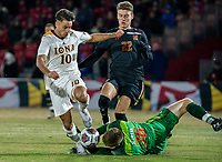 COLLEGE PARK, MD - NOVEMBER 21: Niklas Neumann #36 of Maryland dives at the feet of Najim Romero #10 of Iona during a game between Iona College and University of Maryland at Ludwig Field on November 21, 2019 in College Park, Maryland.