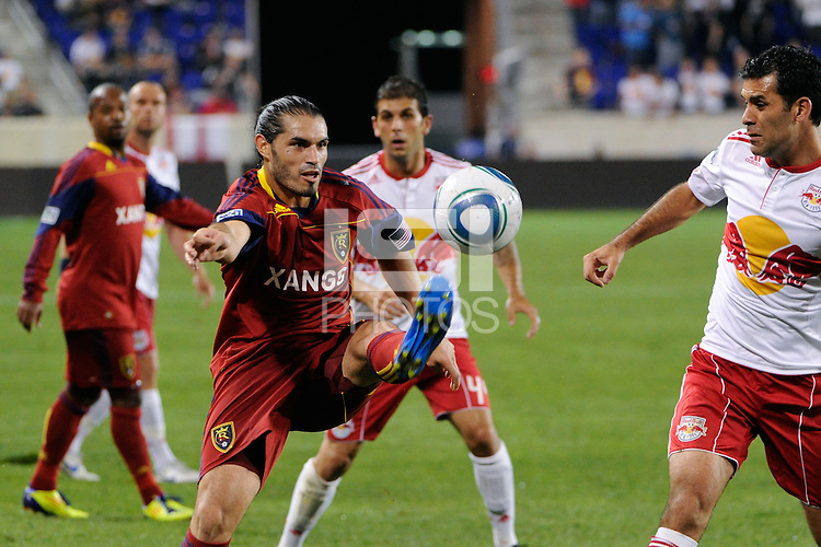 Fabian Espindola (7) of Real Salt Lake plays the ball as Rafa Marquez (4) of the New York Red Bulls defends. Real Salt Lake defeated the New York Red Bulls 3-1 during a Major League Soccer (MLS) match at Red Bull Arena in Harrison, NJ, on September 21, 2011.