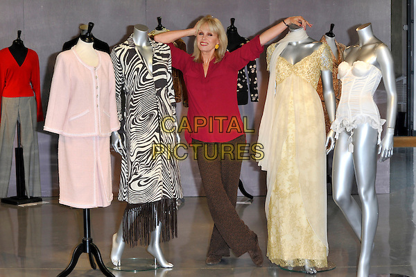 Joanna Lumley.Photocall to promote auction of her clothing worn in various TV programs, held at Kerry Taylor Auctions, Long Lane, Borough, London, England..November 12th, 2012.full length red top brown trousers mannequins leaning hand arm pink black white gold dress jacket zebra animal print .CAP/CJ.©Chris Joseph/Capital Pictures.