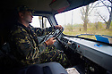Logging in the Chernobyl Exclusion Zone - an employee of the zone authority drives through the CEZ during a forestry survey in October, 2012.
