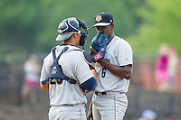Charleston RiverDogs catcher Kale Sumner (23) has a chat on the mound with starting pitcher Luis Severino (6) during the game against the Hickory Crawdads at L.P. Frans Stadium on May 25, 2014 in Hickory, North Carolina.  The RiverDogs defeated the Crawdads 17-10.  (Brian Westerholt/Four Seam Images)